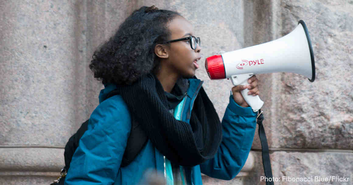 Student Protesting with a megaphone