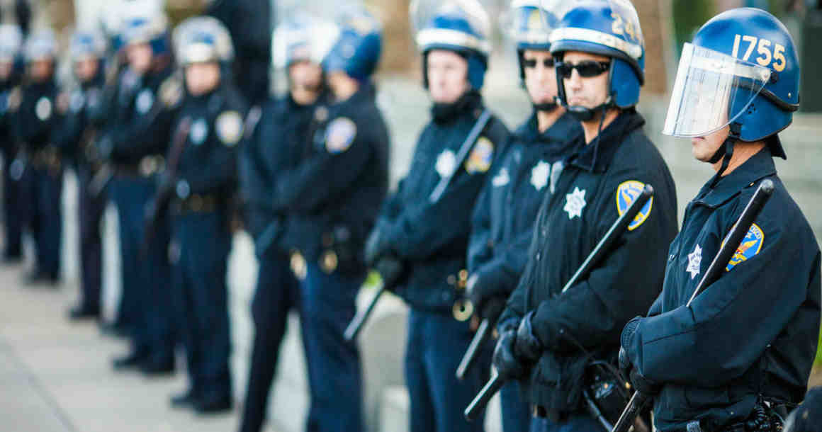 Line of police officers in protective gear