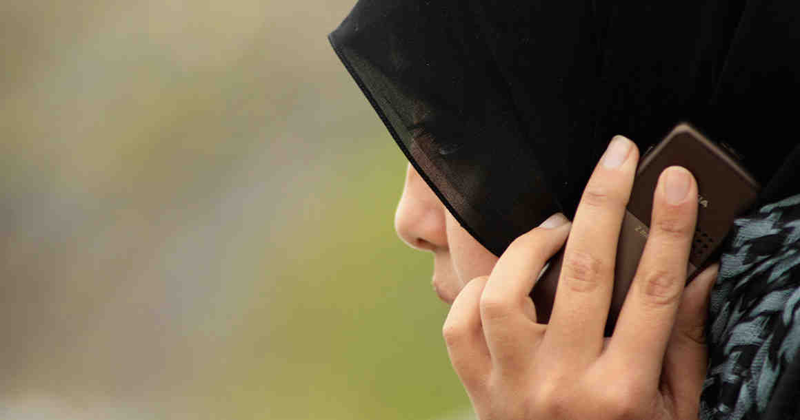 Woman wearing hijab on phone