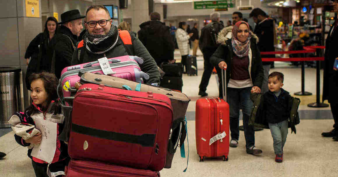 Iraqi refugee family arriving at John F. Kennedy International Airport