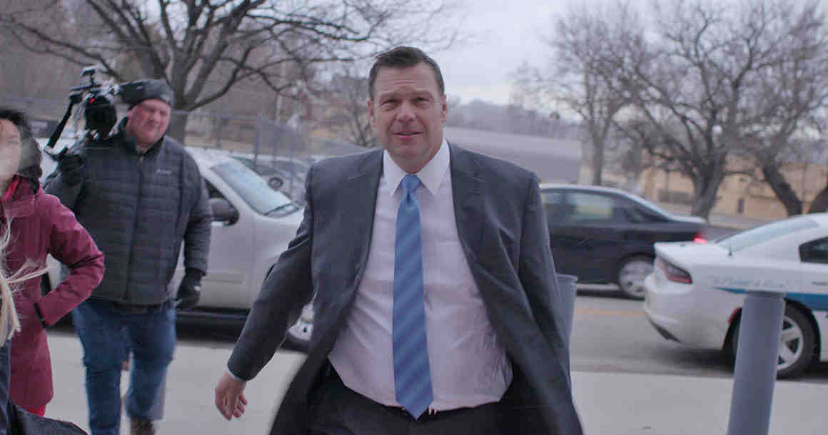 Kobach looking forlorn