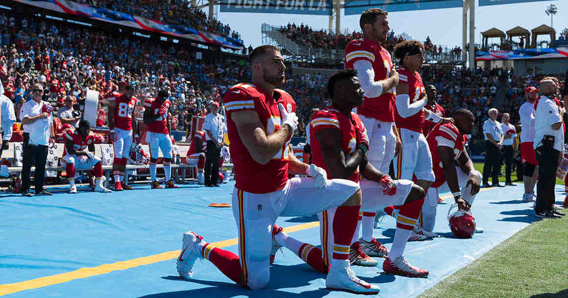NFL players kneeling for national anthem, with some standing