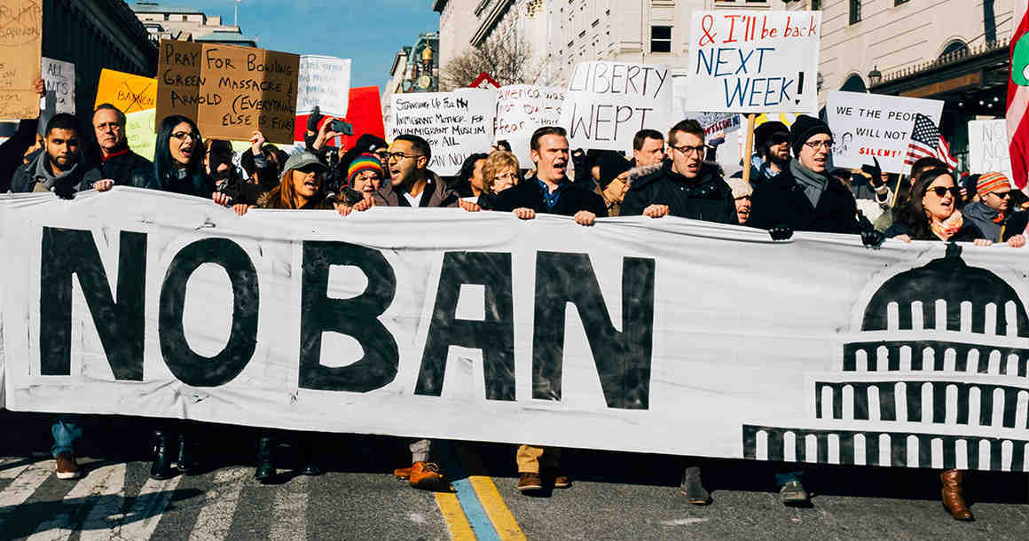 """No Ban Banner"" sign at protest"