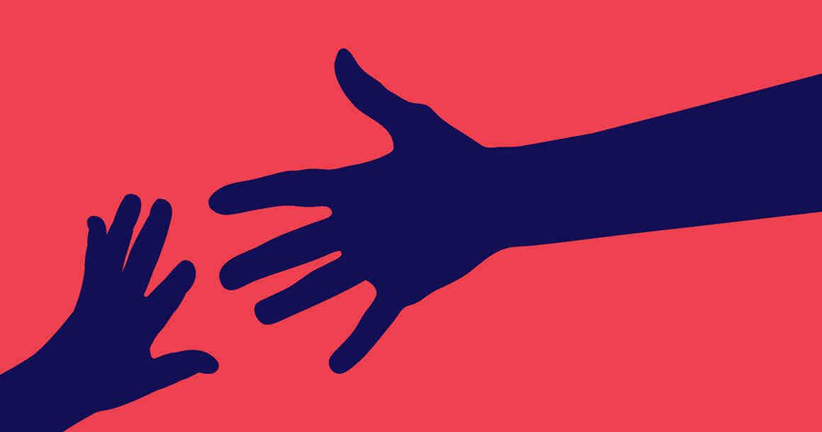Child's hand reaching towards parent's hand