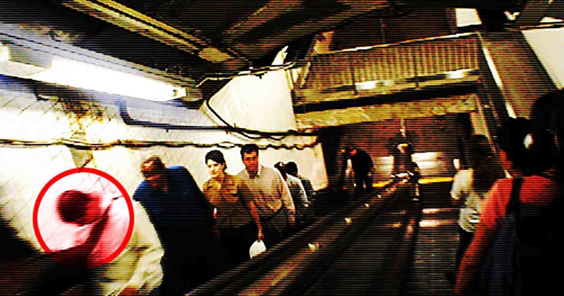 Man being profiled on escalator