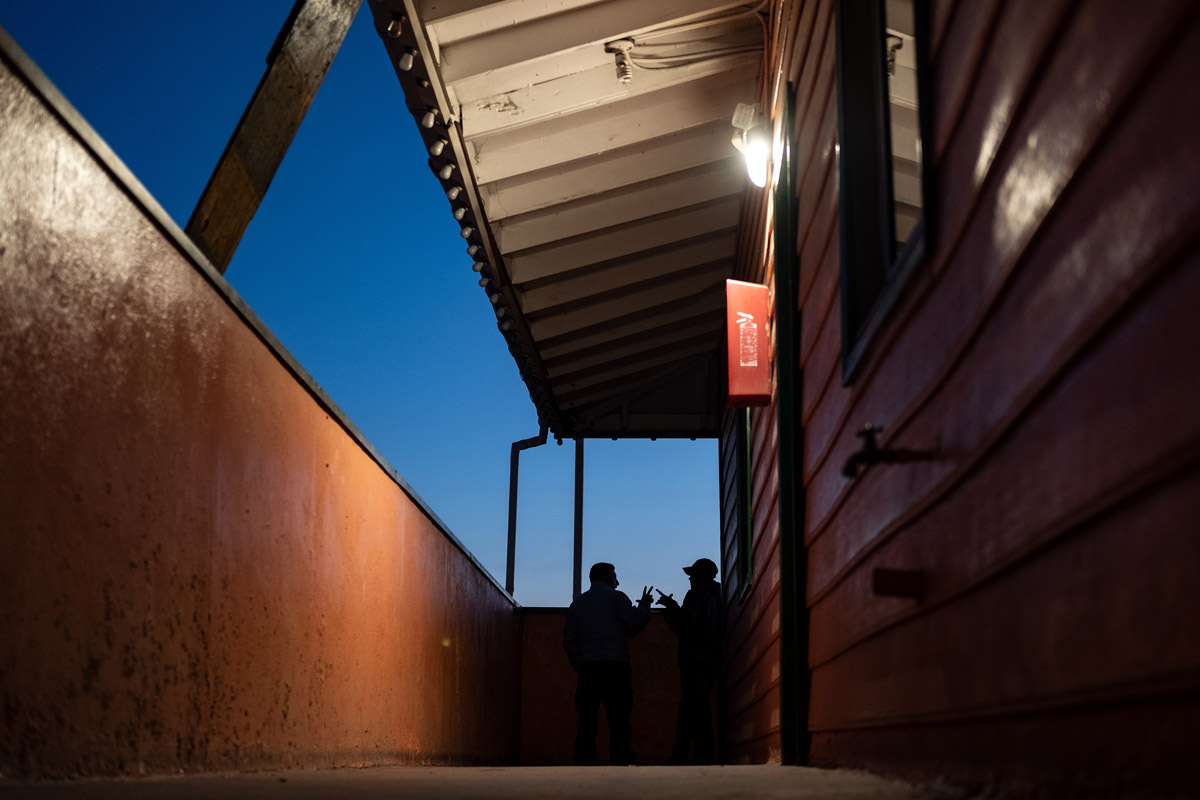 Two Asylum Seekers talking at Dusk