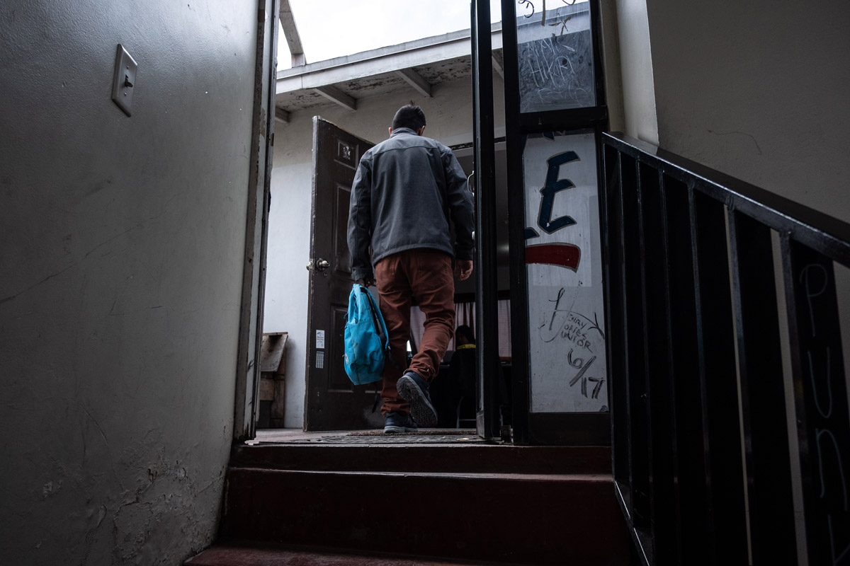 Asylum seeker walks into the house where he sleeps in Tijuana.