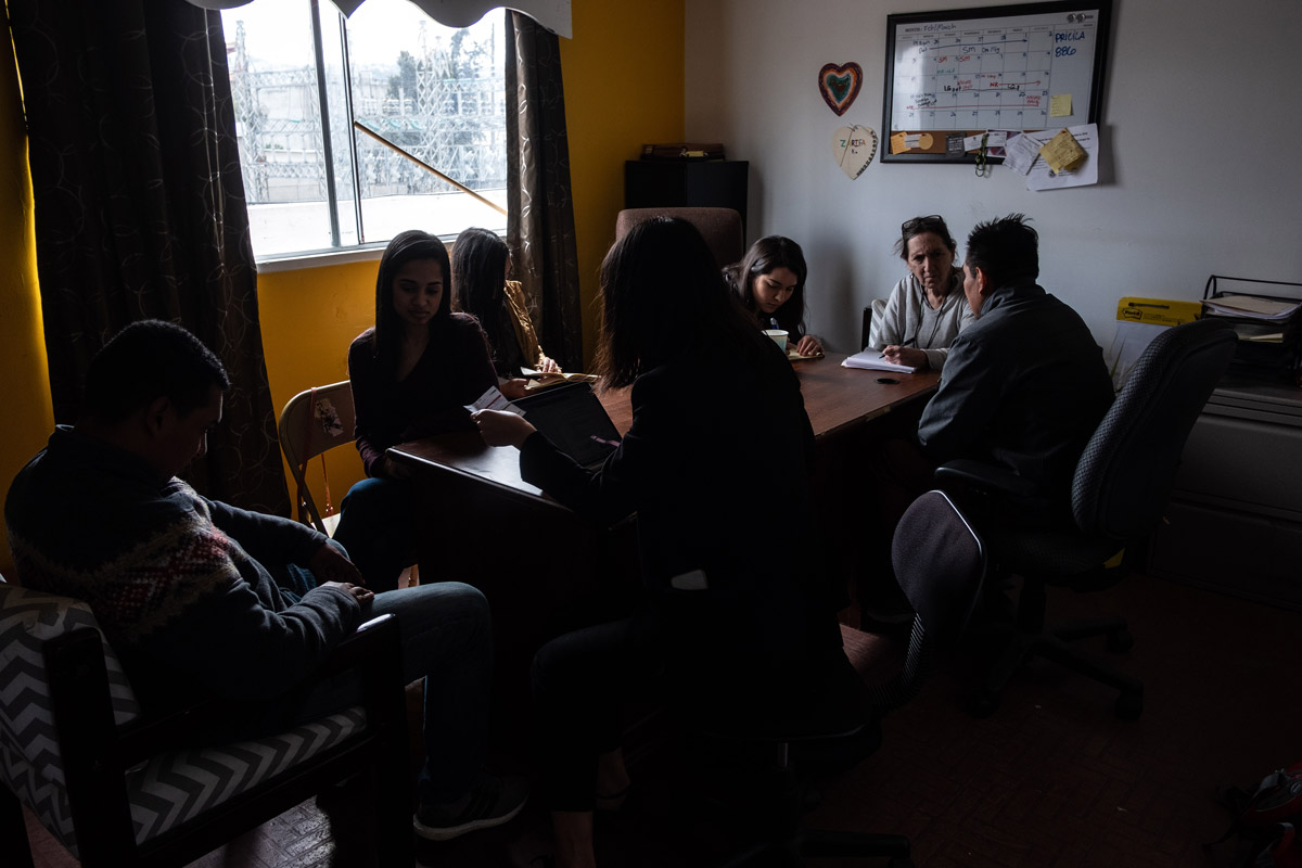 Asylum seekers and legal team meet at a community center in Tijuana.