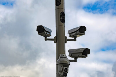 Surveillance cameras on a street pole.