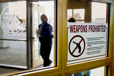 A sign at the entrance of the city hall in Anchorage, Alaska, that warns handgun owners that guns are prohibited in the building.